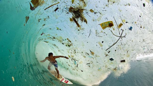 Fully sick: Surfer rides trashiest wave