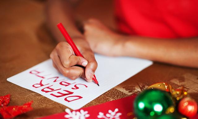 Child writing Santa letter