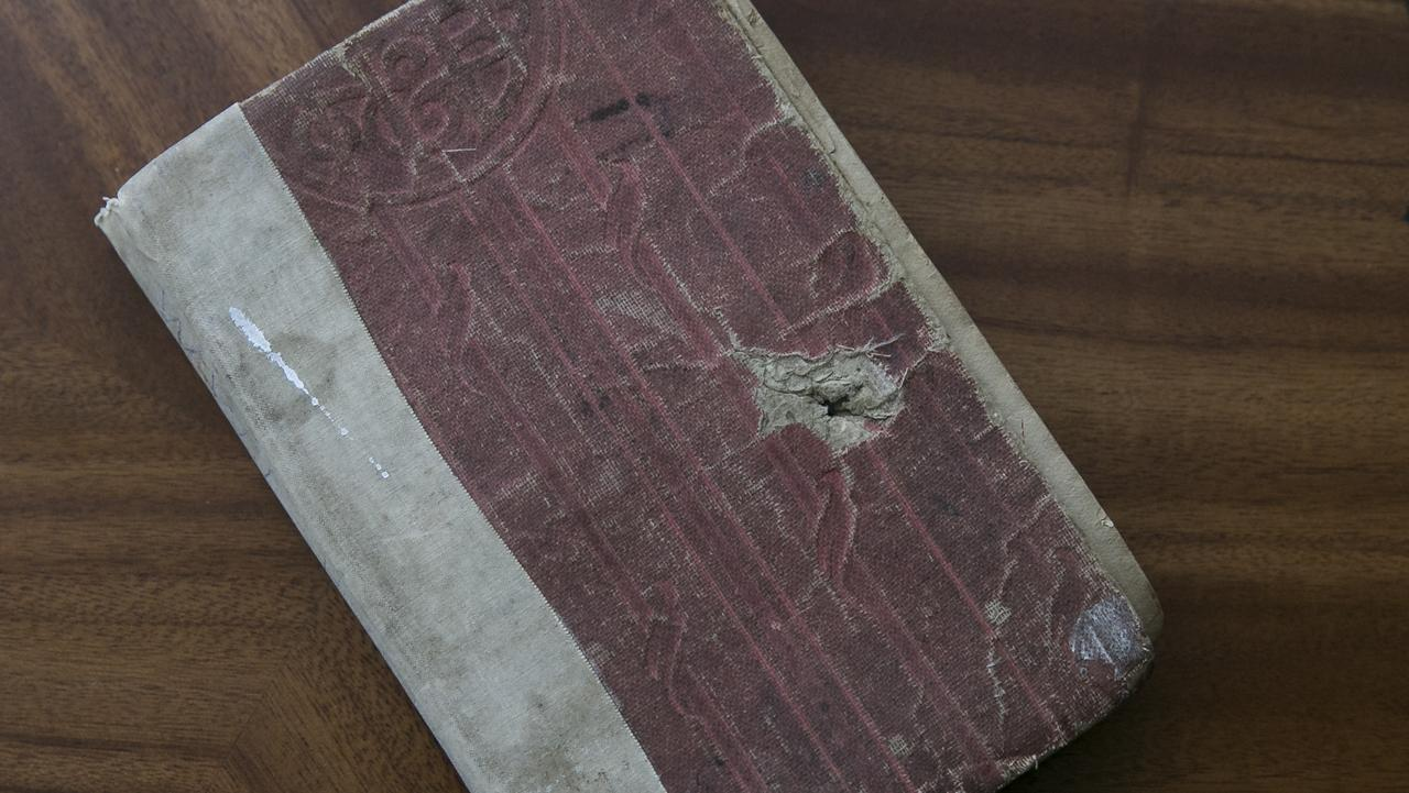 Albert Lightfoot's book with the bullet hole in the front cover. Picture: Dylan Robinson