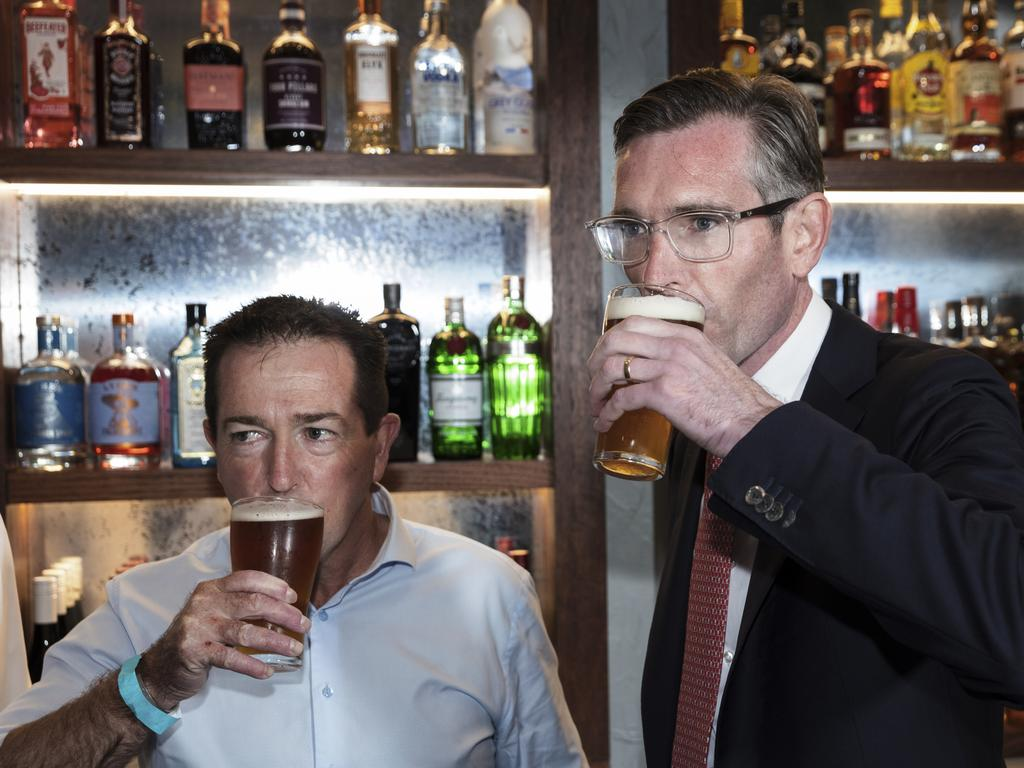 Premier Dominic Perrottet was slammed after he was caught breaching NSW public health rules by drinking alcohol while standing up. Picture: Brook Mitchell/Getty Images