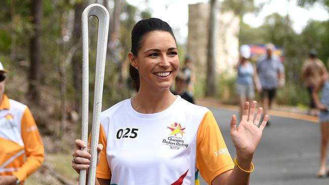 Rooney carries the Queen's Baton at the end of the Brighton leg of the relay in Brisbane last month. Picture: AAP Image/Dan Peled