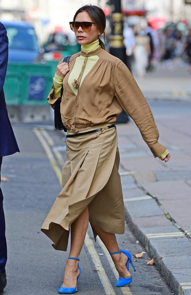 A beige outfit with a yellow turtleneck underneath, paired with some bright blue shoes. Let's leave that one to the professionals. Picture: Backgrid