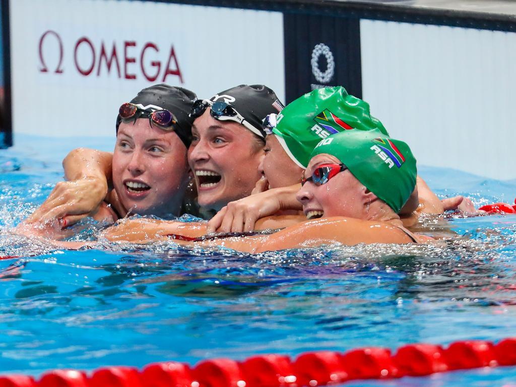 Lilly King, Annie Lazor, Tatjana Schoenmaker and Kaylene Corbett embrace following Schoenmaker's world record 200m breastroke. Picture: Roger Sedres/Gallo Images