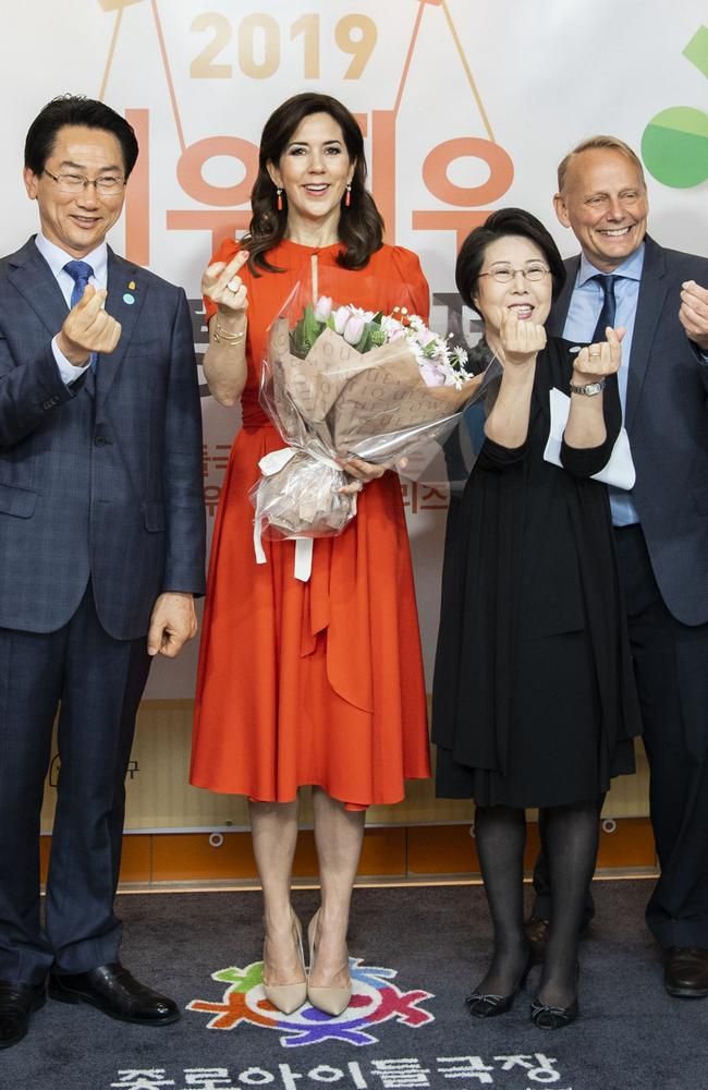 Oops! Crown Princess Mary where she was seen accidentally flipping the bird while clicking her fingers. Picture: MEGA