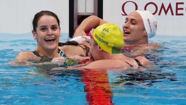 Kaylee McKeown celebrates with Emily Seebohm  and Kylie Masse of Canada after winning the gold medal in the Women's 100m Backstroke Final at the Tokyo 2020 Olympic Games. Photo: Jamie Squire/Getty Images