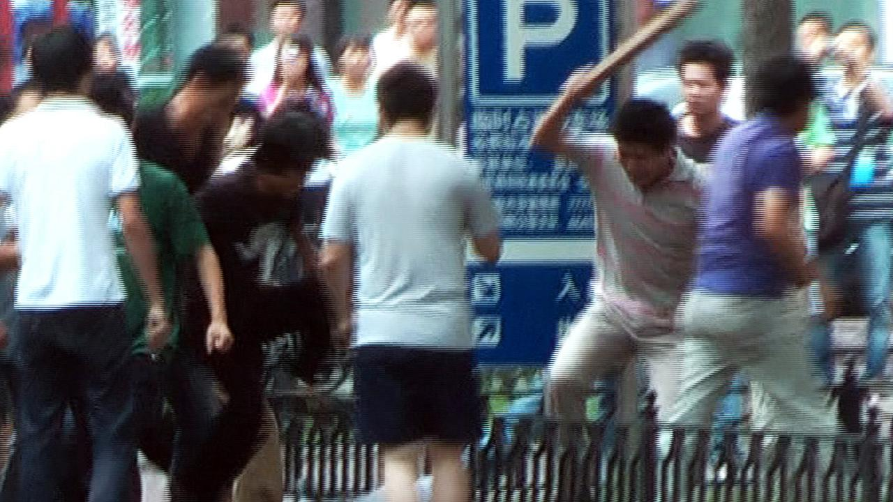 A mob of Han Chinese attacking a lone Uighur man in Urumqi in 2009. Picture: AFP
