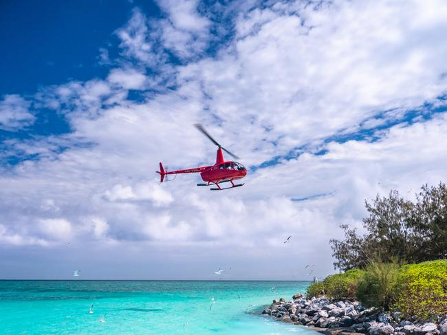 HELICOPTER LANDING AT HERON ISLAND The flight to Heron Island from Gladstone takes around 25 minutes and includes incredible views of Mast Head Island, Erskine Reef and Wistari Reef before arriving at Heron Island. Picture: Mark Fitz