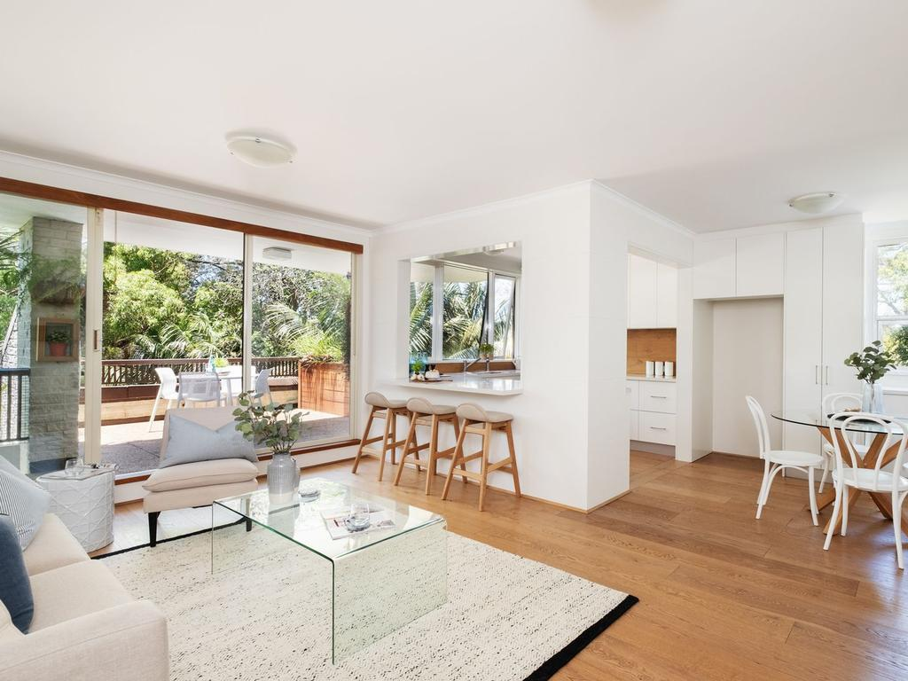 The open plan living room flows out to the terrace.