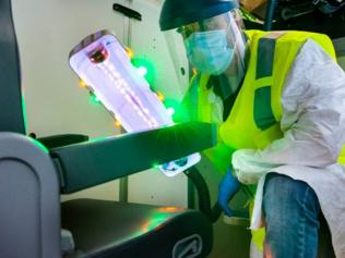 Boeing has been working with Etihad and ANA to develop a UV light that disinfects aircraft cabins and cockpits. According to Boeing, interior surfaces of an aircraft can be scanned with the UV light from inches away and the areas and surfaces where the light falls will be disinfected. Picture: Boeing