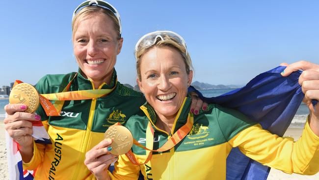 Katie Kelly (right) with guide Michellie Jones after winning gold in the women's triathlon.