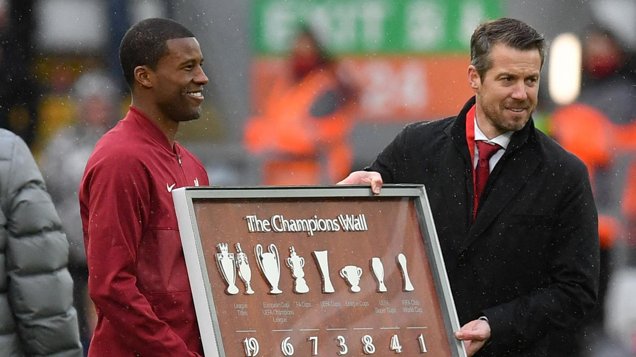 Georginio Wijnaldum is presented with a plaque following his final game. (Photo by Paul ELLIS / POOL / AFP)