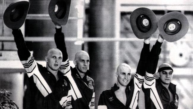 """30 Jul 1986 /Edinburgh, Scotland — With their heads shaven, the four members of Aust's """" mean machine """" L/R Greg Fasalla, Mathew Renshaw, Mark Stockwell, Neil Brooks with their gold medals after winning final of the men's 4 x 100m freestyle relay pic AAP sport o/seas britain swimming headshot"""