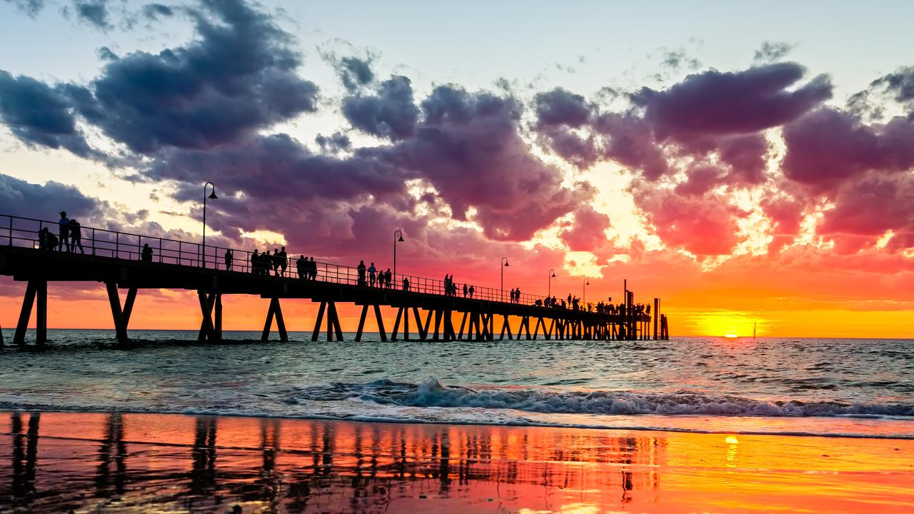 Away from the city, take a dip, stroll the jetty, then grab a bite to eat at Glenelg Beach.