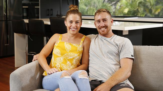 Tenille Patterson and Zach Strasser posing at their renovated Stafford Heights home. (AAP Image/Josh Woning)