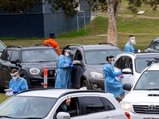 BRISBANE AUSTRALIA - NewsWire Photos AUGUST 3, 2021: Cars fill the oval at Indooroopilly State School where COVID-19 testing is being carried out for staff, students and their families after student's tested positive. NCA NewsWire / Sarah Marshall
