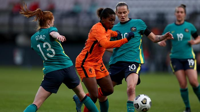 NIJMEGEN, NETHERLANDS - APRIL 13: Lineth Beerensteyn of Netherlands is tackled by Beatrice Goad and Emily van Egmond of Australia during the International Friendly match between Netherlands Women and Australia Women at Stadion de Goffert on April 13, 2021 in Nijmegen, Netherlands. Sporting stadiums around the Netherlands remain under strict restrictions due to the Coronavirus Pandemic as Government social distancing laws prohibit fans inside venues resulting in games being played behind closed doors. (Photo by Dean Mouhtaropoulos/Getty Images)