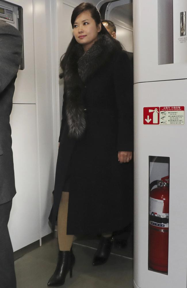 North Korean Hyon Song Wol, head of North Korea's art troupe, walks onto a train at the Seoul Train Station in Seoul. Picture: AP