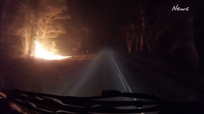 Incredible footage of a fire truck's close call on the NSW south coast