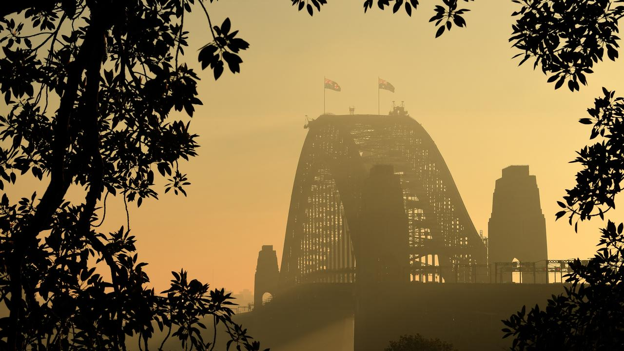 Smoke over Sydney Harbour Bridge on Friday morning. Picture: Dean Lewins