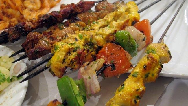 Brochettes, Morocco Chicken, lamb or beef is prepared on a skewer with fat and a rich mix of herbs like parsley, mint, cumin, coriander and onions. It is grilled. Go to the markets to try this delectable kebab dish. Picture: wEnDy / Flickr