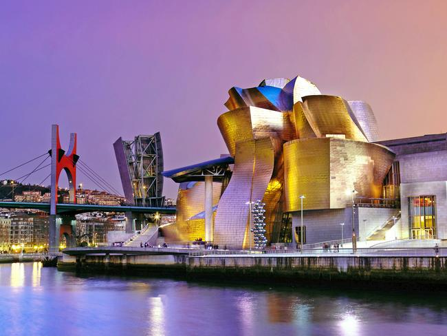 41. GUGGENHEIM BILBAO, SPAIN This shiny titanium building on the banks of Spain's Ría del Nervión not only brought new life to the former industrial site but pays homage to the city's industries of shipbuilding and fishing. It does this in its celebrated architecture incorporating ship shapes, towers, flying fins, and giant tiles that look like fish in the building's facade. Picture: Alamy