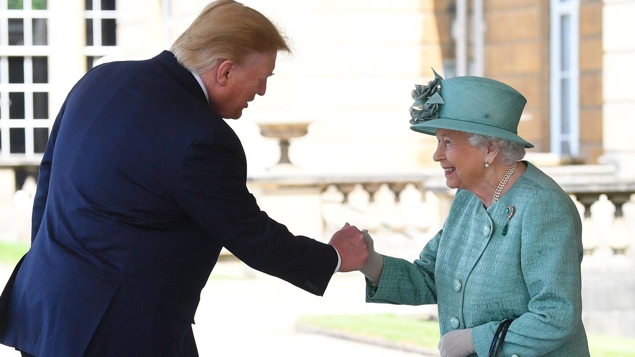 US President Donald Trump appears to fist pump the Queen during their greeting at Buckingham Palace. Picture: Getty Images