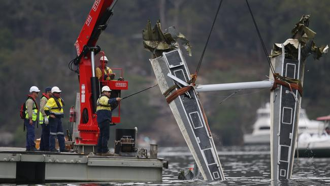 Part of the plane is lifted from the Hawkesbury River. Picture: Richard Dobson