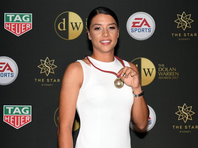 W-League player Sam Kerr poses with the Julie Dolan Medal at the Dolan Warren Awards in Sydney in May.