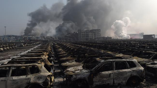 Wasteland ... Rows of Volkswagen cars were burnt out by the neighbouring inferno.