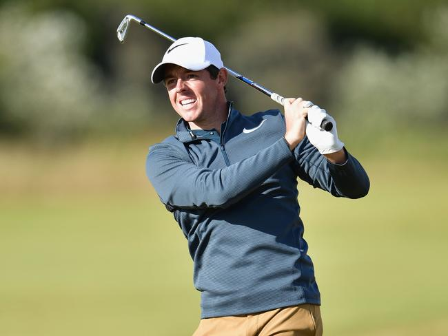 Rory McIlroy of Northern Ireland hits a shot from the 15th hole during the first round.