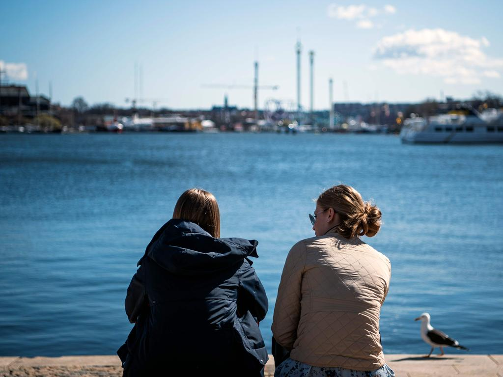 Two women enjoy the spring weather in Stockholm. Picture: Jonathan NACKSTRAND/ AFP
