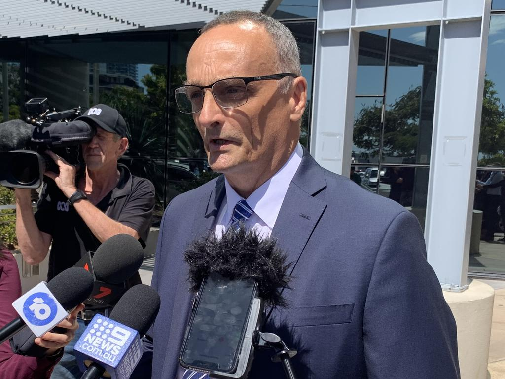 Ardent Leisure chief executive officer John Osborne reads a statement after the company is fined $3.6m over Dreamworld's fatal Thunder River Rapids ride tragedy.