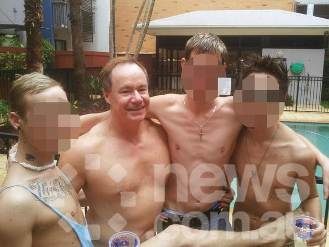 Michael Atkins with young men at his Brisbane flat where he held 'pool parties' for the men he met in Brisbane nightclubs after Matthew Leveson's death.