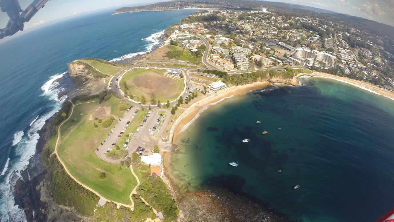 ESCAPE: PACIFIC COAST SUMMER GUIDE .. Jennifer Ennion story .. Flying high above Terrigal, on the Central Coast, with Microlight Adventures. Picture: Jennifer Ennion