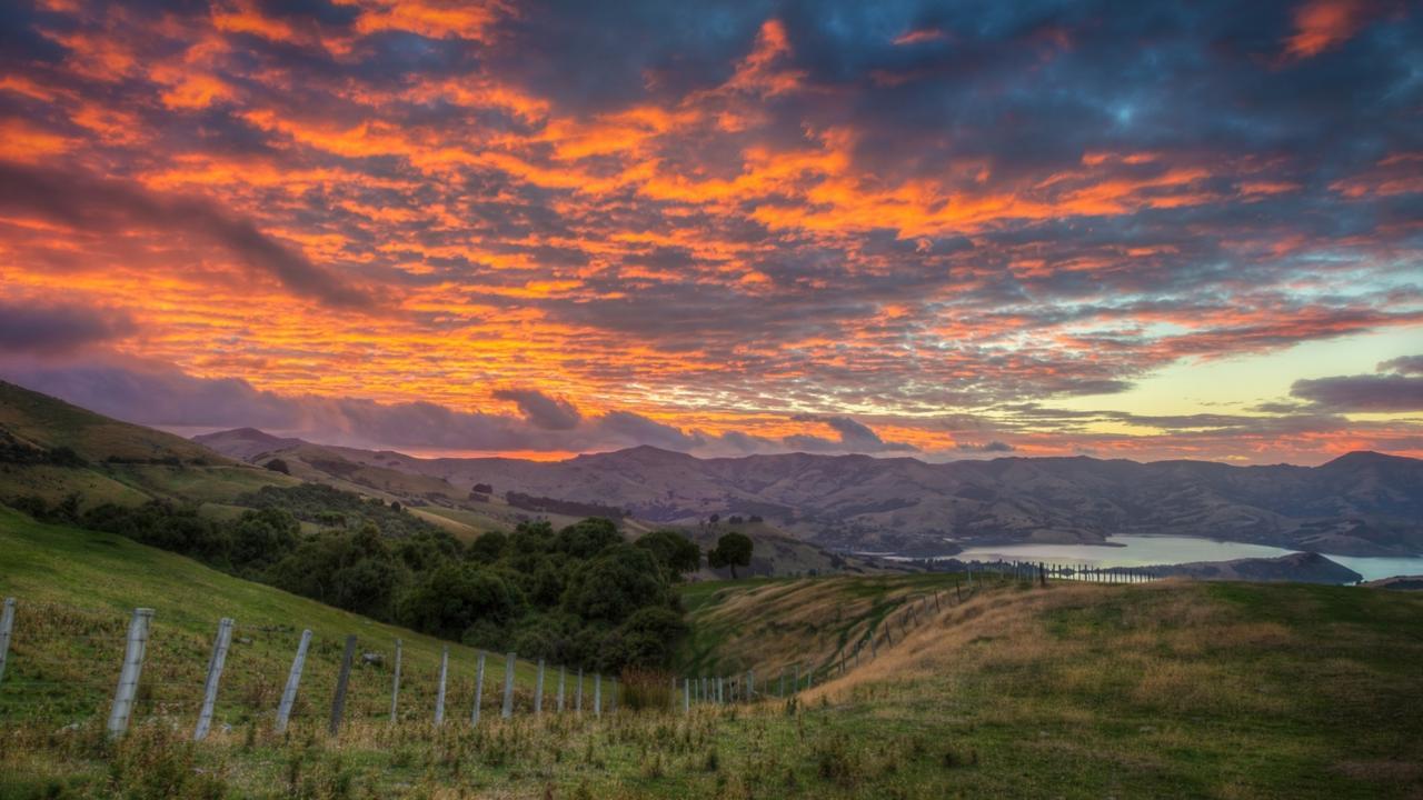 A fiery sky at sunrise in Akaroa, South Island.