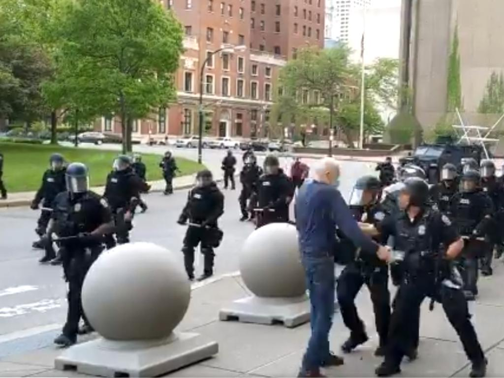 Mr Gugino approaching the group of riot police. Picture: Mike Desmond/WBFO NPR/AFP