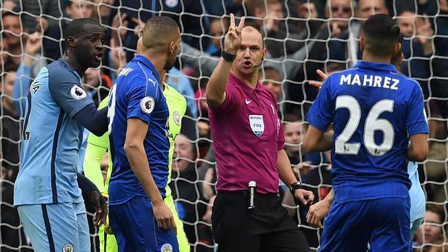 English referee Robert Madley disallows Riyad Mahrez's penalty.
