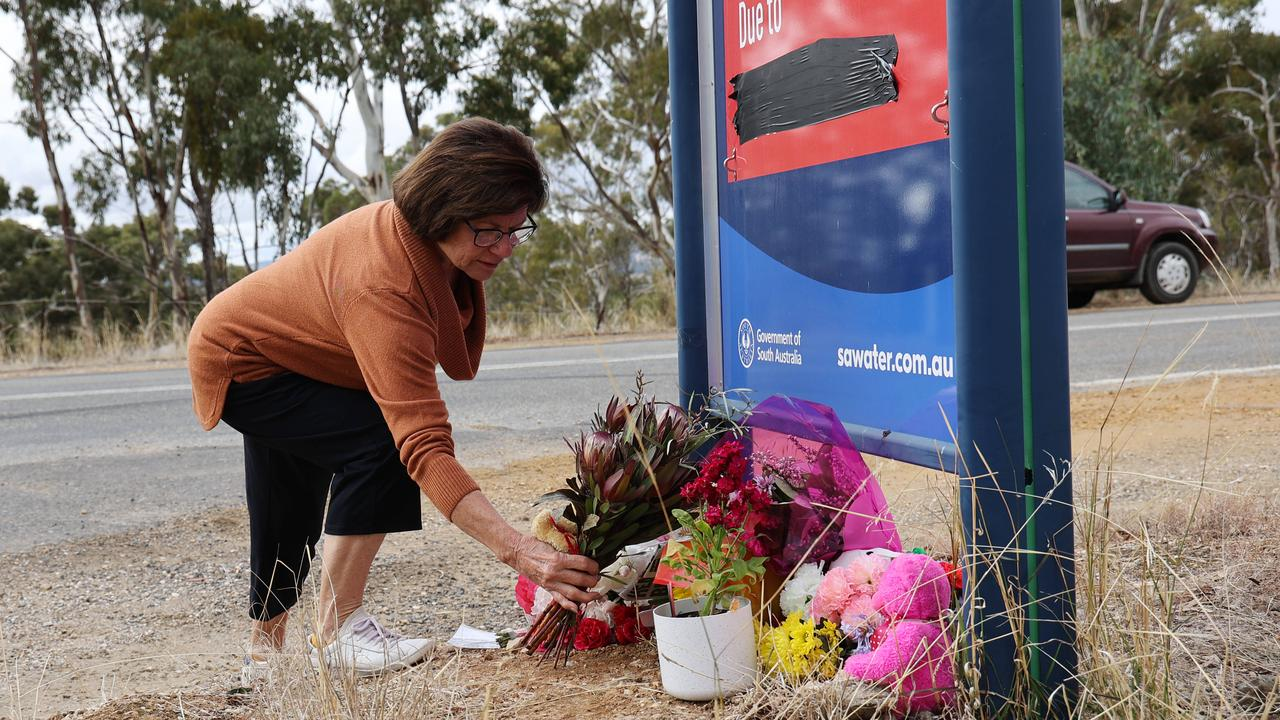 A woman leaves flowers for Kobi at the growing memorial site. Picture: NCA NewsWire / David Mariuz