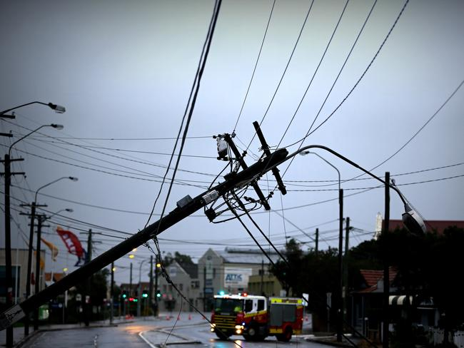 A severe storm still lashing Sydney has caused major damage to the electrical system. This power pole on the Princess Highway is one of many to have come down in the winds.