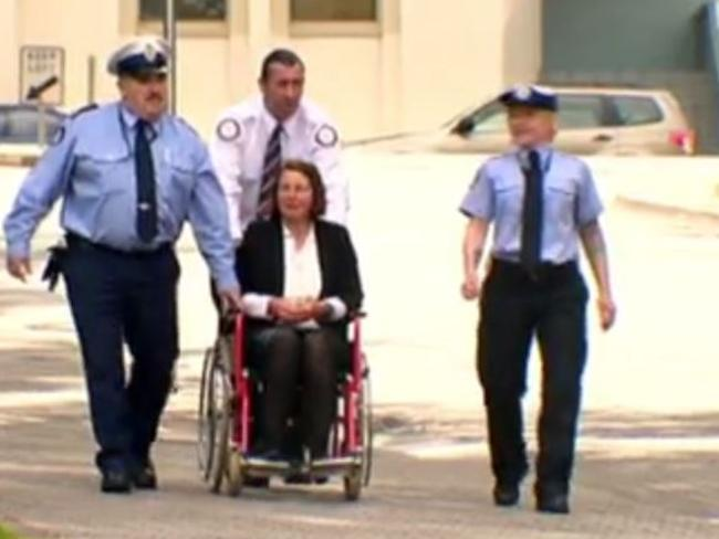 Susan Neill-Fraser in the company of officers after leaving prison where her health and spirits have plummeted. Picture: Sunday Night.