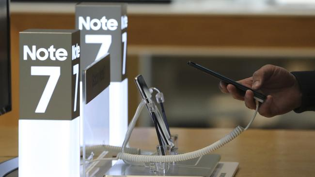 A shopper tries out a Samsung Electronics Galaxy Note 7 smartphone, now removed from sale. Picture: Lee Jin-man.