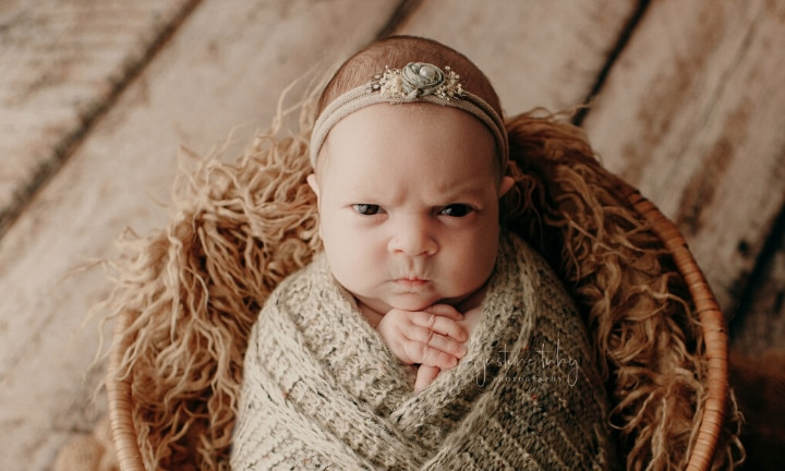 Baby's adorable grumpy newborn shoot goes viral
