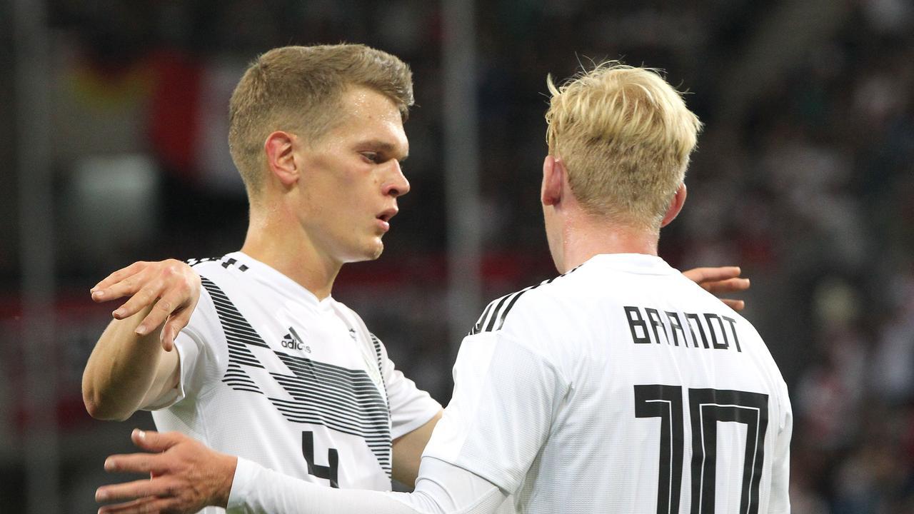 Germany's Julian Brandt (R) celebrates scoring