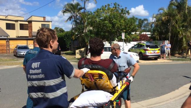 Paramedics take a victim to hospital after the Mermaid Waters overdose.