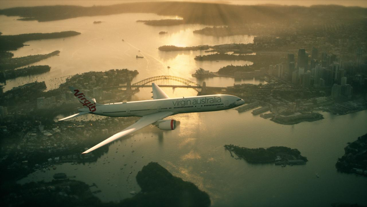 A Virgin Australia plane flying over Sydney Harbour at sunrise. Tourism Australia and Virgin Australia team up to target Americans watching the Oscars. Picture: Supplied