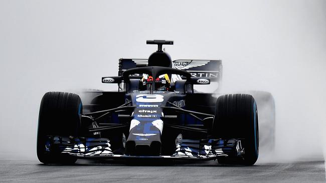 Daniel Ricciardo driving the Aston Martin Red Bull Racing RB14.