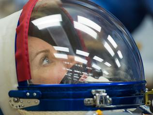 "This NASA handout photo shows Expedition 64 NASA astronaut Kate Rubins seen as she has her Russian Sokol suit pressure checked as she and fellow crewmates Sergey Kud-Sverchkov and Sergey Ryzhikov of Roscosmos prepare for their Soyuz launch to the International Space Station on October 14, 2020, at the Baikonur Cosmodrome in Kazakhstan. - The trio launched at 1:45 a.m. EDT to begin a six-month mission aboard the International Space Station. (Photo by Andrey SHELEPIN / NASA / AFP) / RESTRICTED TO EDITORIAL USE - MANDATORY CREDIT ""AFP PHOTO /NASA/GCTC/ANDREY SHELEPIN/HANDOUT "" - NO MARKETING - NO ADVERTISING CAMPAIGNS - DISTRIBUTED AS A SERVICE TO CLIENTS"