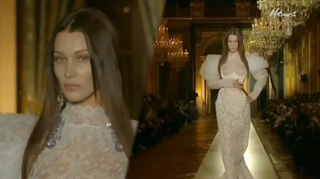 Bella Hadid walks runway in revealing wedding gown