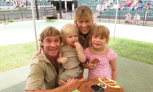 TV presenter adventurer crocodile hunter Steve Irwin with wife Terri and children Bindi and Bob eating birthday cake on Bob's second birthday 01 Dec 2005 at Australia Zoo.