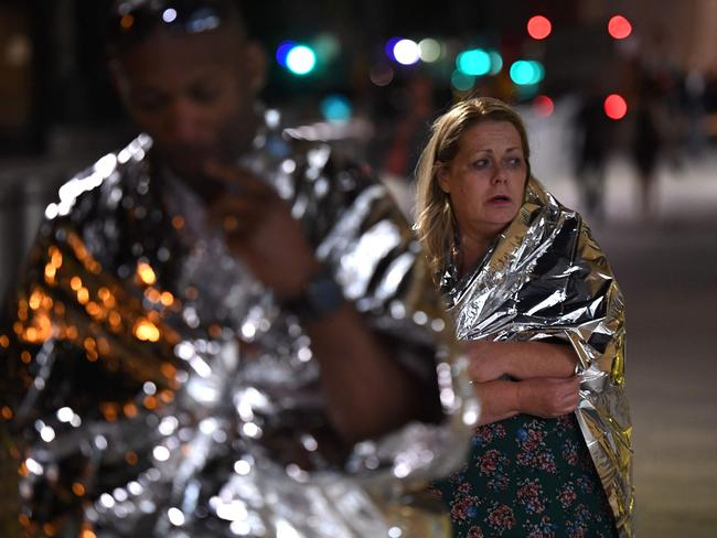 Members of the public, wrapped in emergency blankets leave the scene of a terror attack on London Bridge. Picture: AFP